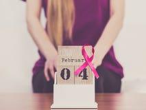 妇女和世界在日历的乳腺癌天 库存图片
