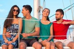妇女和人游艇的 免版税库存照片