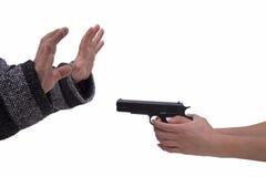 妇女和人的手有手枪的 图库摄影