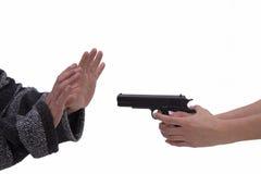 妇女和人的手有手枪的 免版税库存照片