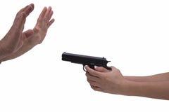 妇女和人的手有手枪的 库存图片