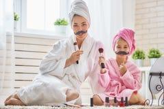 妇女和女孩有髭的在棍子 免版税库存图片