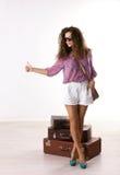 妇女和手提箱 图库摄影
