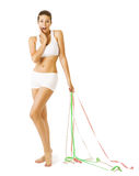 妇女和测量的磁带,减肥稀薄的女孩白色内衣 免版税库存照片