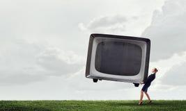 妇女和电视显示器 混合画法 免版税库存图片