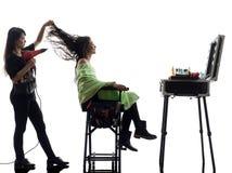 妇女和美发师剪影 库存图片