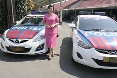 妇女和警车 免版税图库摄影