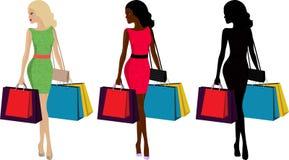 妇女和购物 免版税库存照片
