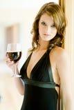 妇女和酒 免版税库存照片