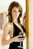 妇女和酒 免版税库存图片