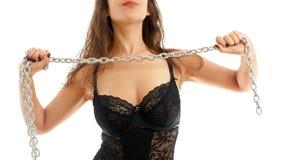 妇女和钢链子 图库摄影