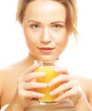 妇女喝橙汁的被隔绝的射击 库存照片