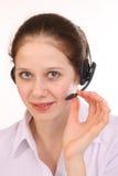 妇女回答电话 免版税图库摄影