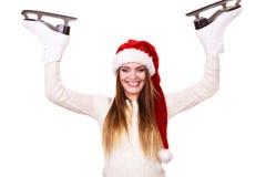 妇女圣诞老人与滑冰 免版税库存图片