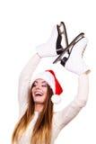 妇女圣诞老人与滑冰 免版税图库摄影
