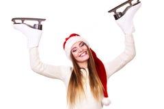 妇女圣诞老人与滑冰 库存图片