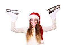 妇女圣诞老人与滑冰 库存照片