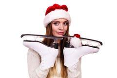 妇女圣诞老人与滑冰 免版税库存照片