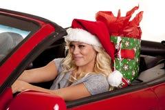 妇女圣诞老人帽子汽车礼品驱动器 库存照片