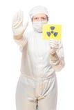 妇女在与辐射的受影响的区域在防护套服 免版税图库摄影