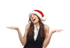 妇女在圣诞老人帽子 免版税库存照片