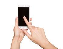 妇女在她的手上的拿着智能手机 手指感人的显示 库存图片