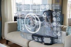 妇女在家坐佩带虚拟现实耳机的沙发 免版税图库摄影