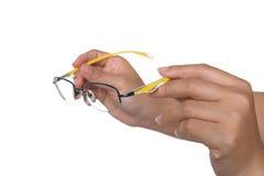 妇女在手上的拿着黄色玻璃 图库摄影