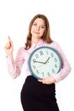妇女在手时钟举行 人力的情感 库存图片