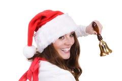 妇女在敲响响铃的圣诞老人帽子 免版税库存照片