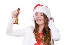 妇女在敲响响铃的圣诞老人帽子 图库摄影