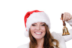 妇女在敲响响铃的圣诞老人帽子 库存照片