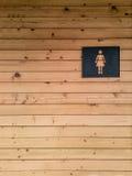 妇女在木的洗手间标志 图库摄影