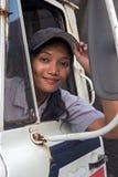 妇女在汽车的卡车司机 免版税库存照片