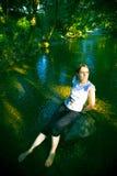 妇女在河 库存照片