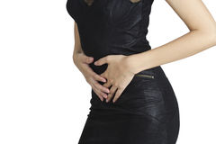 妇女在痛苦中的握她的胃,当红色被突出在白色背景的痛苦区域 免版税库存图片