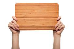 妇女在白色背景递拿着木空白被隔绝 免版税库存图片