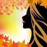 妇女在秋天 免版税库存图片