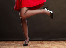 妇女在红色礼服的零件身体 图库摄影