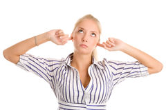 妇女在耳朵插入手指 库存图片
