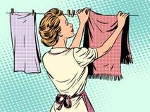 妇女在洗涤主妇以后垂悬衣裳 向量例证