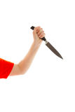 妇女在他的手上拿着一把刀子 库存图片