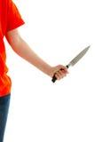 妇女在他的手上拿着一把刀子 免版税库存照片