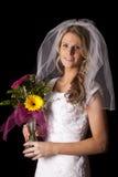 妇女在黑花微笑的婚礼礼服 免版税库存图片
