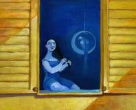 妇女坐与她的鹦鹉的一个窗口 免版税库存照片