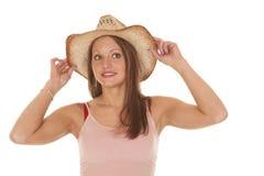 妇女女牛仔帽子举行双方 免版税图库摄影