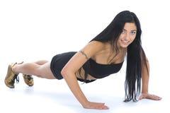 妇女实践的健身 免版税图库摄影