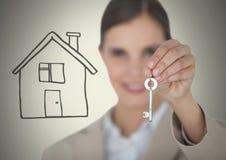 妇女对负关键与在小插图前面的房子图画 免版税图库摄影