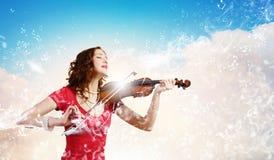 妇女小提琴手 图库摄影