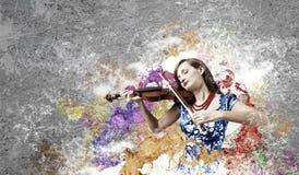 妇女小提琴手 免版税库存照片
